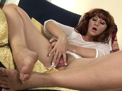 Katia knows how to make herself very comfortable on that armchair! She spreads her thighs and gives