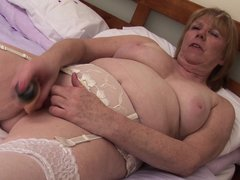 Lustful mature lady with her huge naughty boobs wants to have some pleasure all by herself so she ta