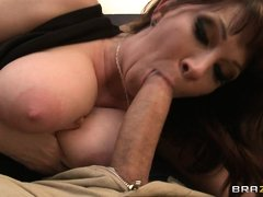 This Milf has got really big boobs and she is licking her big tits while this guy is pressing her bo
