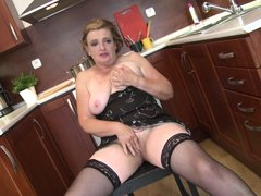 Martina K. takes a break from cooking to spread her legs wide so you can see her old, hairy cunt. Sh