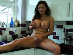 curvaceous brunette sienna finger-fucks her cunt in the kitchen