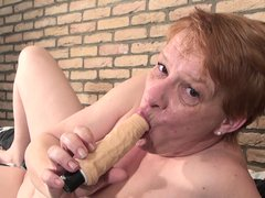 Angel Fire is a sexy milf. This bitch has got busty boobs and nice body. He re she is getting out of