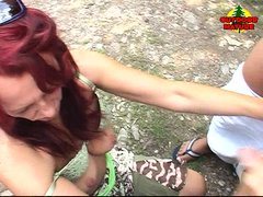 Laurie is naughty mature redhead that knows hot to make a male happy. She is outside in an uninhabit