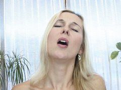 blonde milf pleasing her shaved cunt