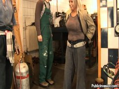 All those heavy machines and busy workers, what does this blonde looks for inside the workshop? Well