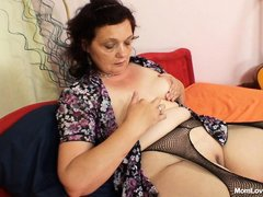 This women wearing sexy pantyhose is in her bed playing guitar. She take of her blouse and start tou