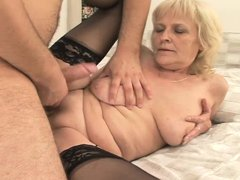 Our granny bounces her saggy tits like a cheap whore, ridding this dude's cock with her bald snatch.