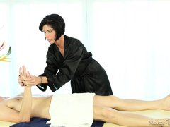 Dark haired beauty Fox wears her black robe and slowly massages her client. Her skilled hands slide