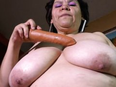 mature lady plays with dildo