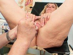 Tamara is at the gynecologist's office getting her pussy examined. The doc swabs her inside, then re