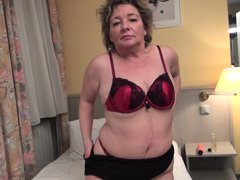 she takes off her clothes revealing a sexy body that asks fort cock and semen. the European mature h