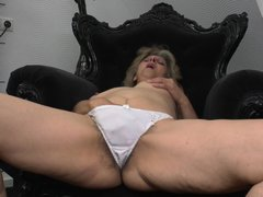 This horny mature is lost in her masturbation. Look how this naked slut who is only in her panties m