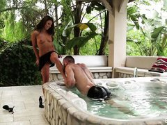 hot couple get naked in an outdoor tub