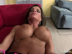 This brunette is getting fucked rashly on sofa. He is fucking her from behind with her legs up, she