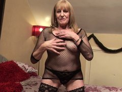 Hannah is a horny old lady who is playing with her body like a whore. See her undressing and showing
