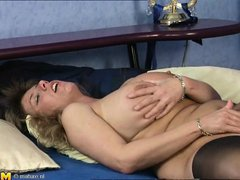 This sexy blonde women is in her bedroom wearing sexy lingerie and pantyhose. Now she takes off her